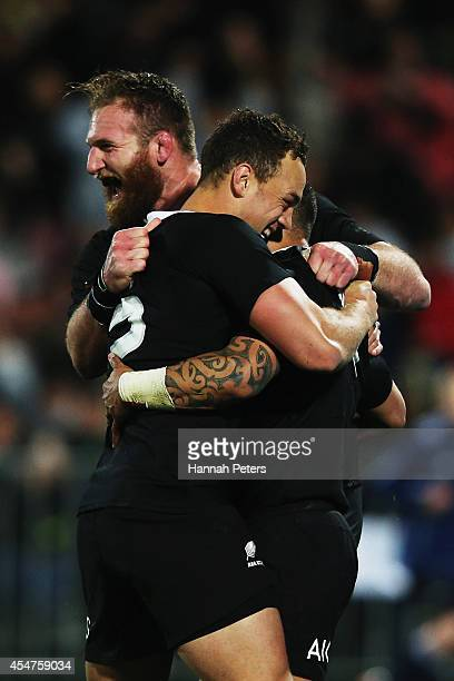 Aaron Smith of the All Blacks celebrates with Kieran Read and Israel Dagg after scoring a try during The Rugby Championship match between the New...