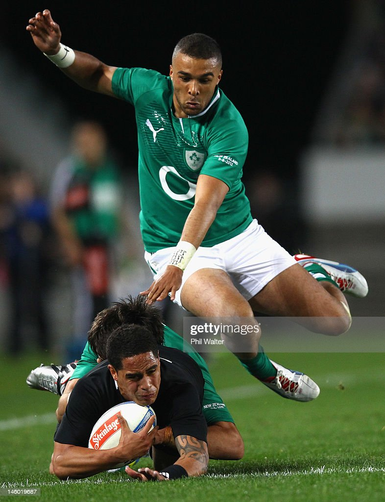 Aaron Smith of the All Blacks dives under the tackle of Simon Zebo of Ireland during the International Test Match between the New Zealand All Blacks and Ireland at Eden Park on June 9, 2012 in Auckland, New Zealand.