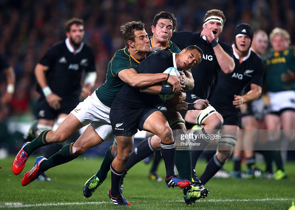 Aaron Smith of the All Blacks is tackled by <a gi-track='captionPersonalityLinkClicked' href=/galleries/search?phrase=JJ+Engelbrecht&family=editorial&specificpeople=7123392 ng-click='$event.stopPropagation()'>JJ Engelbrecht</a> of the Springboks during The Rugby Championship match between the New Zealand All Blacks and the South African Springboks at Eden Park on September 14, 2013 in Auckland, New Zealand.