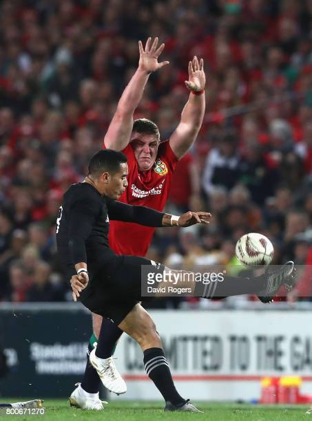 Aaron Smith of the All Blacks kicks the ball past Tadhg Furlong during the Test match between the New Zealand All Blacks and the British Irish Lions...