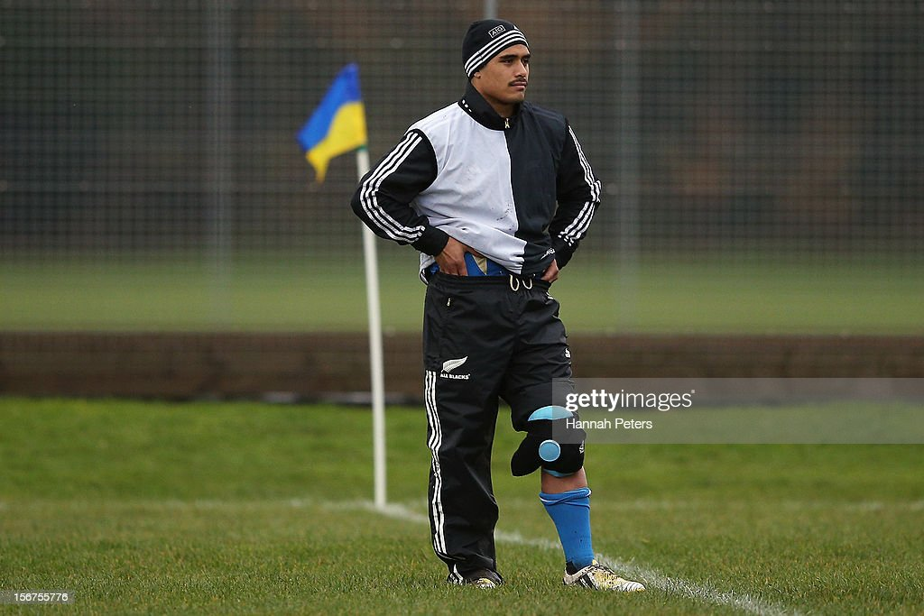 Aaron Smith of the All Blacks looks on from the sideline during a training session at the University of Glamorgan training fields on November 20, 2012 in Cardiff, Wales.