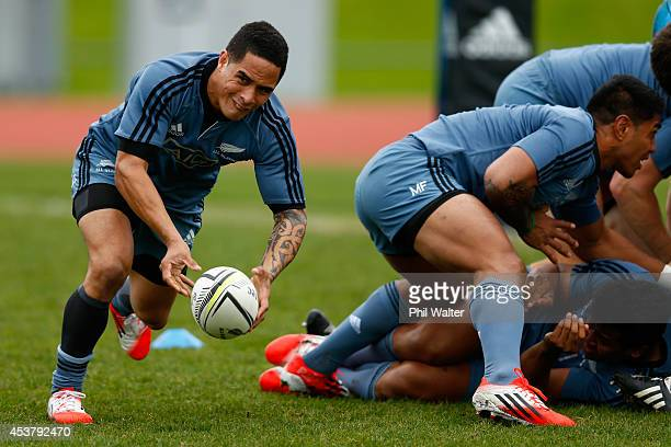Aaron Smith of the All Blacks passes during a New Zealand All Blacks training session at Trusts Stadium on August 19 2014 in Auckland New Zealand