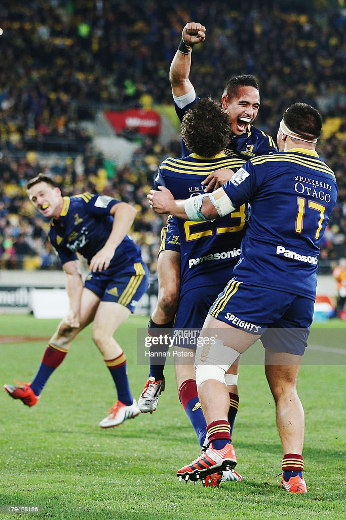 Aaron Smith of the Highlanders celebrates with Marty Banks and Daniel LienertBrown of the Highlanders after winning the Super Rugby Final match...