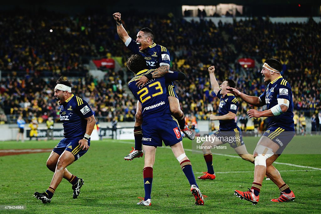 Aaron Smith of the Highlanders celebrates with Marty Banks of the Highlanders after winning the Super Rugby Final match between the Hurricanes and the Highlanders at Westpac Stadium on July 4, 2015 in Wellington, New Zealand.
