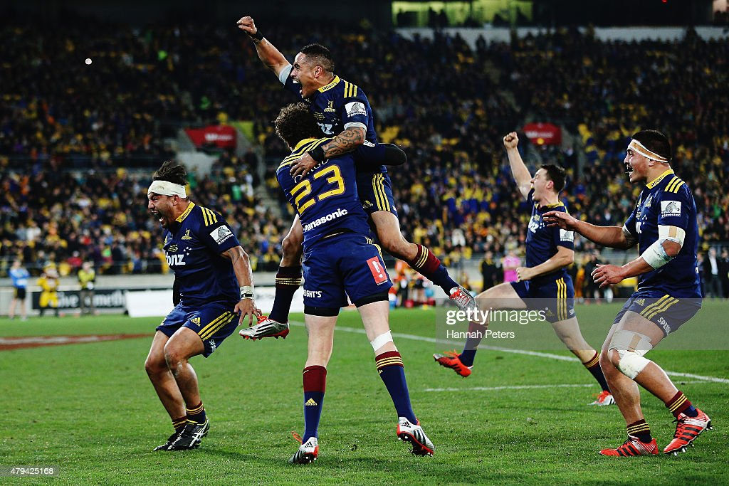 Aaron Smith of the Highlanders celebrates with Marty Banks of the Highlanders after winning the Super Rugby Final match between the Hurricanes and...