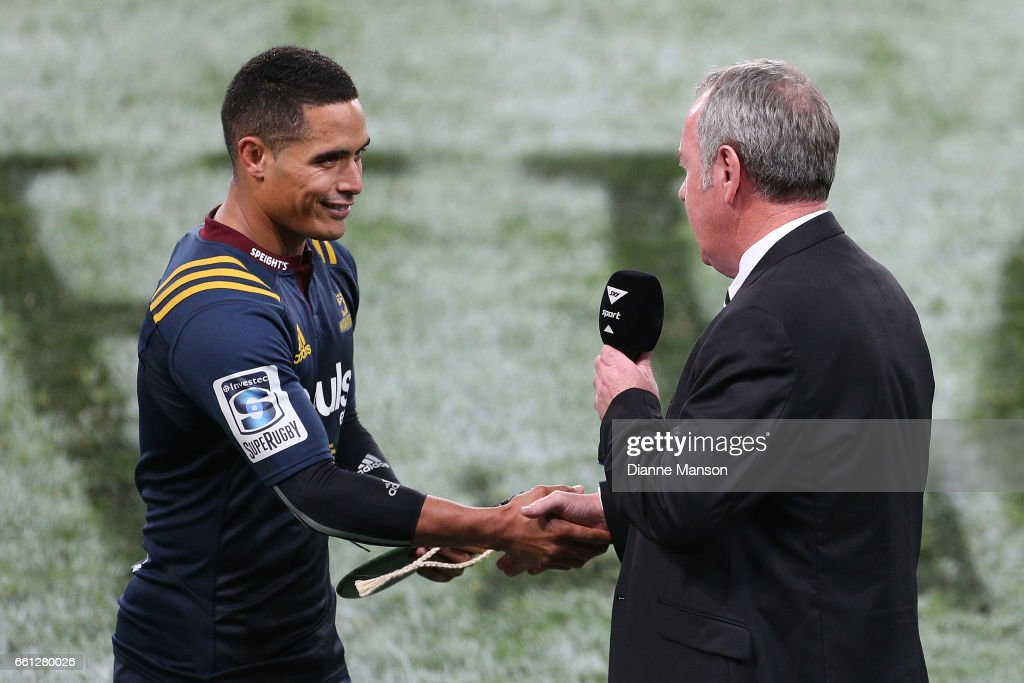 Aaron Smith of the Highlanders is presented a gift from NZRU board member Peter Kean for his 100th match during the round six Super Rugby match between the Highlanders and the Rebels at Forsyth Barr Stadium on March 31, 2017 in Dunedin, New Zealand.