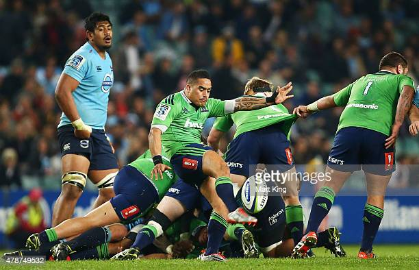 Aaron Smith of the Highlanders kicks during the Super Rugby Semi Final match between the Waratahs and the Highlanders at Allianz Stadium on June 27...