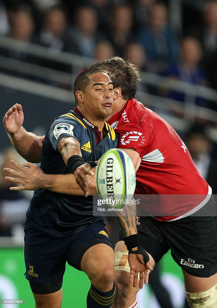Aaron Smith of the Highlanders offloads the ball during the round three Super Rugby match between the Highlanders and the Lions at Rugby Park on...