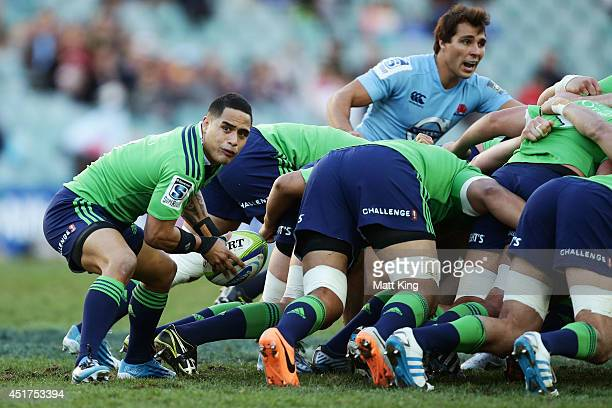 Aaron Smith of the Highlanders passes the ball during the round 18 Super Rugby match between the Waratahs and the Highlanders at Allianz Stadium on...