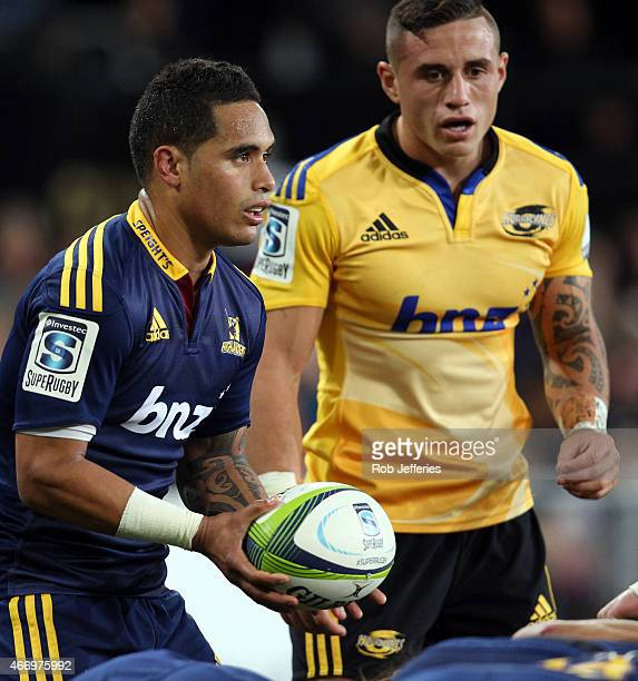 Aaron Smith of the Highlanders prepares to feed the scrum while TJ Perenara of the Hurricanes looks on during the round six Super Rugby match between...