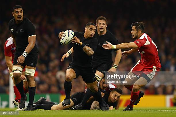 Aaron Smith of the New Zealand All Blacks evades a tackle from Lasha Malaguradze of Georgia during the 2015 Rugby World Cup Pool C match between New...