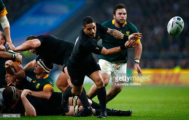 Aaron Smith of the New Zealand All Blacks passes during the 2015 Rugby World Cup Semi Final match between South Africa and New Zealand at Twickenham...