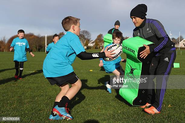Aaron Smith of the New Zealand All Blacks takes a rugby skills clinic with children at the Seapoint Rugby Club prior to their Captains Run on...