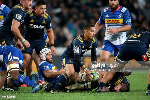 Aaron Smith of the Otago Highlanders looks to run from a ruck during the Super Rugby match between the Otago Highlanders of New Zealand and the...