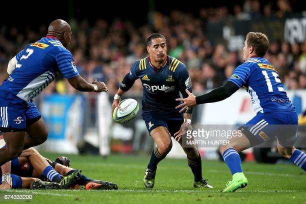 Aaron Smith of the Otago Highlanders looks to run through the defence during the Super Rugby match between the Otago Highlanders of New Zealand and...