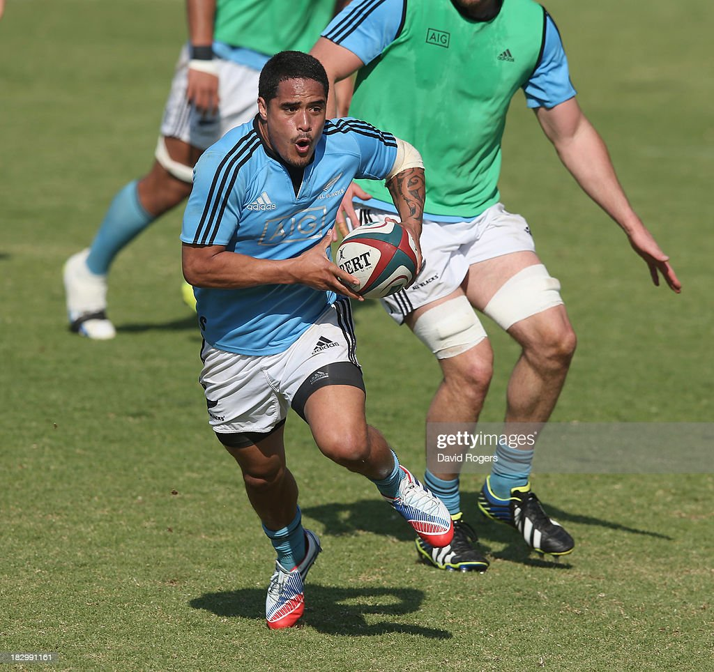 Aaron Smith runs with the ball during the New Zealand All Blacks training session held at Wits University on October 3, 2013 in Johannesburg, South Africa.