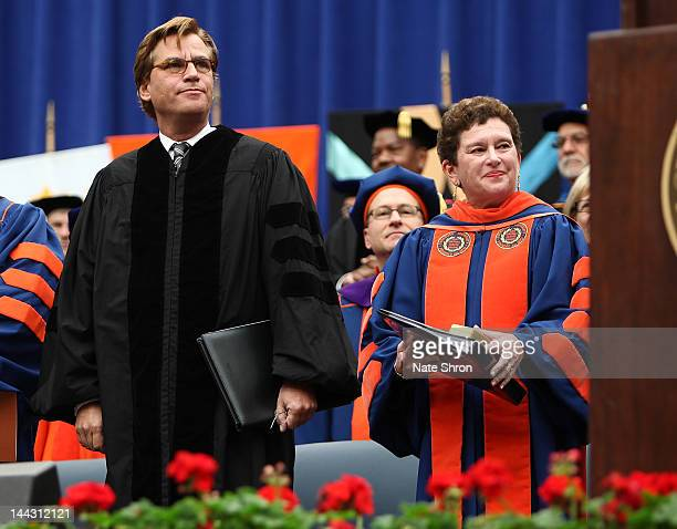 Aaron Sorkin screenwriter producer and playwright and Chancellor and President of Syracuse University Nancy Cantor stand together on stage during the...