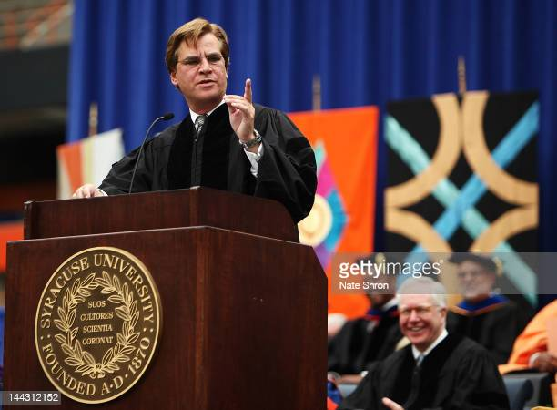 Aaron Sorkin screenwriter producer and playwright points as he looks to the crowd during his address at the 2012 Syracuse University Commencement at...