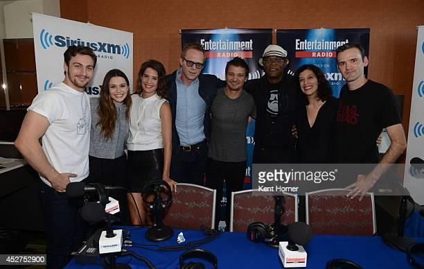 Aaron Taylor Johnson Elizabeth Olsen Cobie Smulders Paul Bettany Jeremy Renner Samuel Jackson pose with radio hosts Jessica Shaw and Dalton Ross...