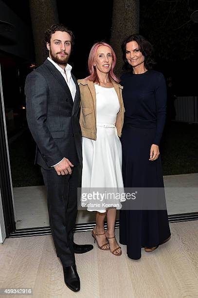 Aaron TaylorJohnson Sam TaylorWood and Rosetta Getty attend NETAPORTER Celebrates Rosetta Getty on November 20 2014 in Los Angeles California