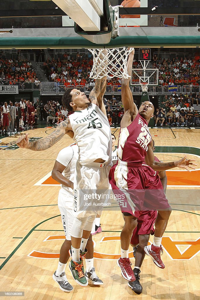 Aaron Thomas #25 of the Florida State Seminoles and Julian Gamble #45 of the Miami Hurricanes battle for the rebound on January 27, 2013 at the BankUnited Center in Coral Gables, Florida. The Hurricanes defeated the Seminoles 71-47.