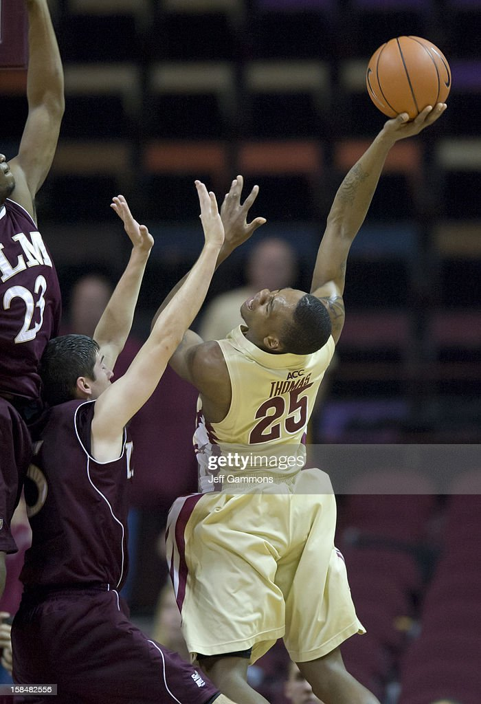 Aaron Thomas #25 of the Florida State Seminoles goes for a shot against Trent Mackey #5 during the game at the Donald L. Tucker Center on December 17, 2012 in Tallahassee, Florida.