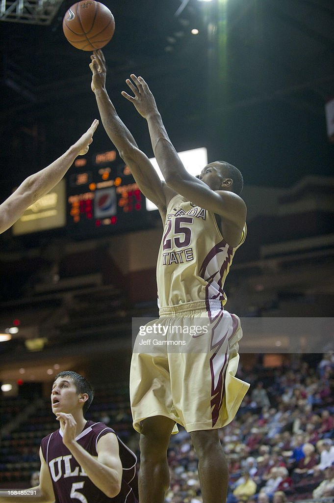 Aaron Thomas #25 of the Florida State Seminoles shoots for three during the game at the Donald L. Tucker Center on December 17, 2012 in Tallahassee, Florida. Florida State won 63-48.