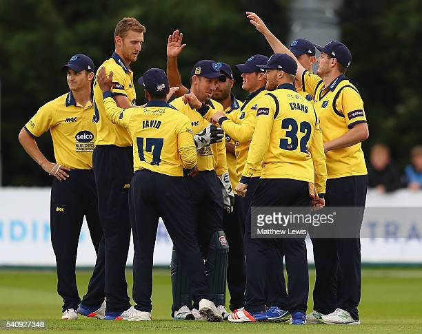 Aaron Thomason of Warwickshire is congratulated on catching Billy Godleman of Derbyshire off the bowling of Oliver HannonDalby during the NatWest T20...