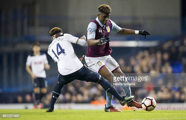 Aaron Tshibola of Aston Villa is challenged by Georges Kevin N'Koudou of Tottenham Hotspur during the FA Cup Third Round match between Tottenham...