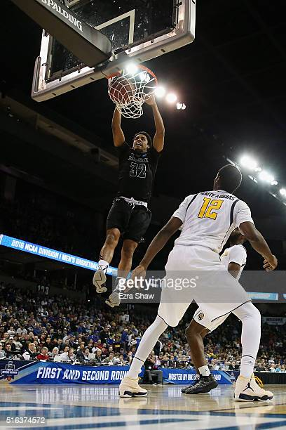 Aaron Valdes of the Hawaii Warriors dunks in front of Roger Moute a Bidias of the California Golden Bears in the second half during the first round...