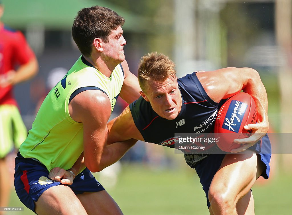 Aaron Vandenberg of the Demons is tackled by Angus Brayshaw during a Melbourne Demons AFL pre-season training session at Gosch's Paddock on February 9, 2016 in Melbourne, Australia.