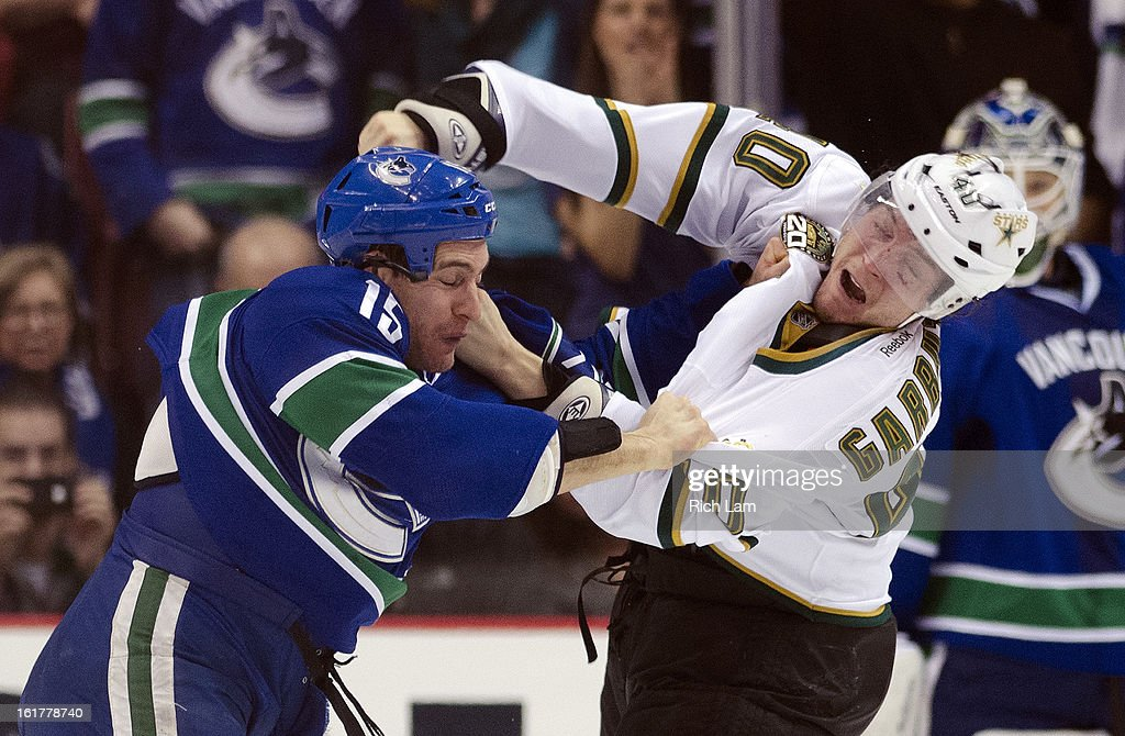 Aaron Volpati #15 of the Vancouver Canucks and Ryan Garbutt #40 of the Dallas Stars exchanges punches during the second period in NHL action on February 15, 2013 at Rogers Arena in Vancouver, British Columbia, Canada.