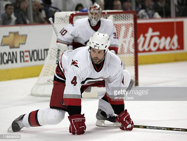 Aaron Ward of the Carolina Hurricanes gets down to defend his net during game 3 of the Eastern Conference Finals versus the Buffalo Sabres at the...
