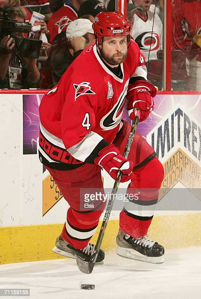 Aaron Ward of the Carolina Hurricanes skates after the puck during game two of the 2006 NHL Stanley Cup Finals against the Edmonton Oilers on June 7...