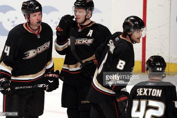 Aaron Ward Saku Koivu Teemu Selanne and Dan Sexton of the Anaheim Ducks stand on the ice during a break in action during the game against the San...