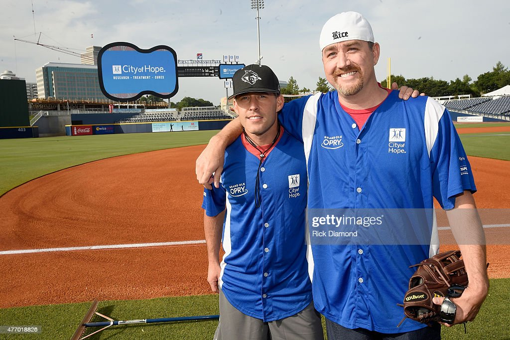 Aaron Watson and Stephen Bess steps up to strike out cancer at the 25th Annual City of Hope Celebrity Softball Game 2015 at First Tennessee Park on June 13, 2015 in Nashville, Tennessee.