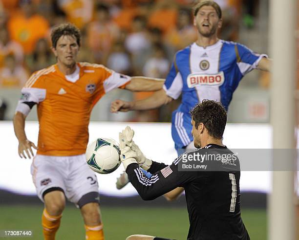 Aaron Wheeler of the Philadelphia Union beats Bobby Boswell of the Houston Dynamo to the ball as he puts it on goal and Tally Hall of the Houston...