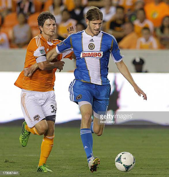 Aaron Wheeler of the Philadelphia Union beats Bobby Boswell of the Houston Dynamo to the ball as he puts it on goal in the first half at BBVA Compass...
