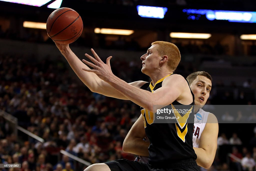 <a gi-track='captionPersonalityLinkClicked' href=/galleries/search?phrase=Aaron+White+-+Basketball+Player&family=editorial&specificpeople=14619648 ng-click='$event.stopPropagation()'>Aaron White</a> #30 of the Iowa Hawkeyes shoots the ball over <a gi-track='captionPersonalityLinkClicked' href=/galleries/search?phrase=Kyle+Wiltjer&family=editorial&specificpeople=7621176 ng-click='$event.stopPropagation()'>Kyle Wiltjer</a> #33 of the Gonzaga Bulldogs in the first half of the game during the third round of the 2015 NCAA Men's Basketball Tournament at KeyArena on March 22, 2015 in Seattle, Washington.