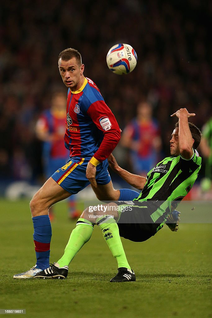 Aaron Wilbraham of Crystal Palace is tackled by <a gi-track='captionPersonalityLinkClicked' href=/galleries/search?phrase=Matthew+Upson&family=editorial&specificpeople=214704 ng-click='$event.stopPropagation()'>Matthew Upson</a> of Brighton & Hove Albion during the npower Championship play off semi final first leg at Selhurst Park on May 10, 2013 in London, England.