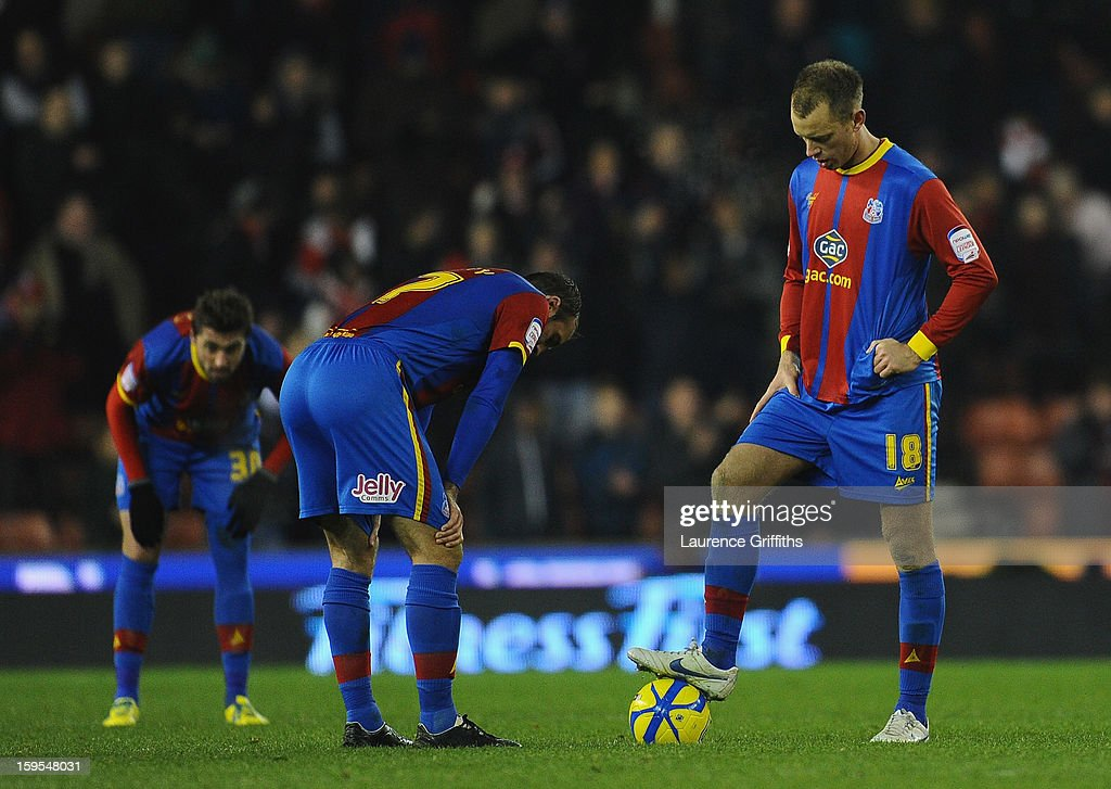 Aaron Williams and Glenn Murray of Crystal Palace show their dissapointment during the FA Cup with Budweiser Third Round replay match between Stoke City and Crystal Palace at Britannia Stadium on January 15, 2013 in Stoke on Trent, England.
