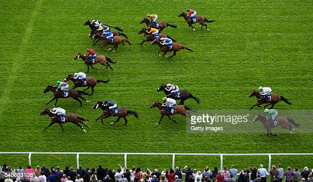 Aaron Williams ridding Royal Birth leads the field to the line to win The Totescoop6 Heritage Handicap Stakes Race run at Ascot Racecourse on July 9...