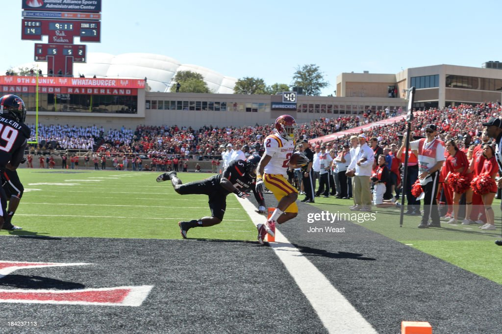 Aaron Wimberly #2 of the Iowa State Cyclones scores a touchdown during game action on October 12, 2013 at AT&T Jones Stadium in Lubbock, Texas. Texas Tech won the game over Iowa State 42-35.