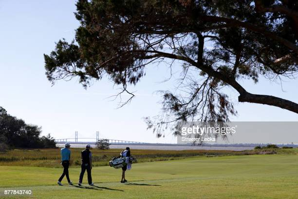 Aaron Wise and Zach Johnson of the United States walk up the fairway on the 13th hole during the final round of The RSM Classic at Sea Island Golf...