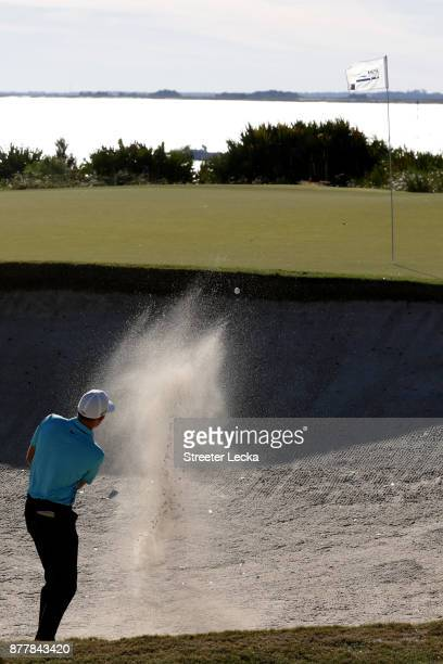 Aaron Wise of United States plays a shot from a bunker on the 13th hole during the final round of The RSM Classic at Sea Island Golf Club Seaside...