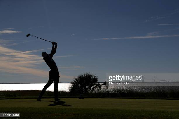 Aaron Wise of United States plays his shot from the 14th tee during the final round of The RSM Classic at Sea Island Golf Club Seaside Course on...