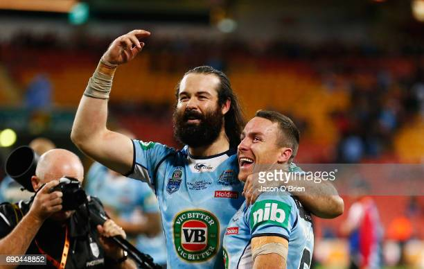 Aaron Woods and James Maloney of the blues celebrate during game one of the State Of Origin series between the Queensland Maroons and the New South...