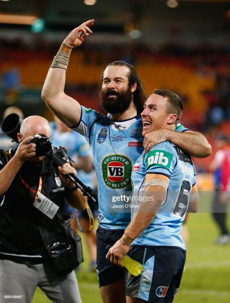 Aaron Woods and James Maloney of the blues celebrate during game one of the State Of Origin series between the Queensland Maroons and the New South Wales Blues at Suncorp Stadium on May 31, 2017 in Brisbane, Australia.
