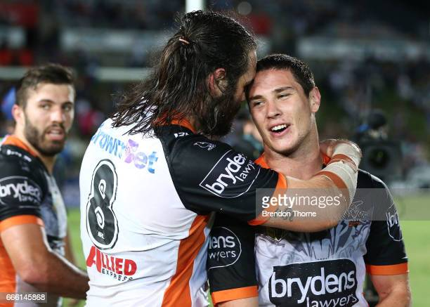 Aaron Woods and Mitchell Moses of the Tigers celebrate at full time during the round six NRL match between the North Queensland Cowboys and the Wests...