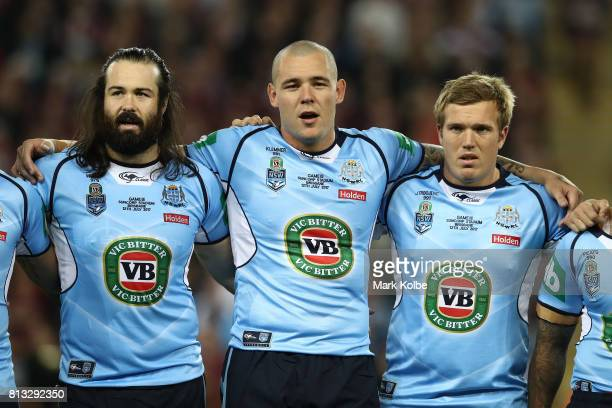 Aaron Woods David Klemmer and Jake Trbojevic of the Blues sings the National Anthem before game three of the State Of Origin series between the...
